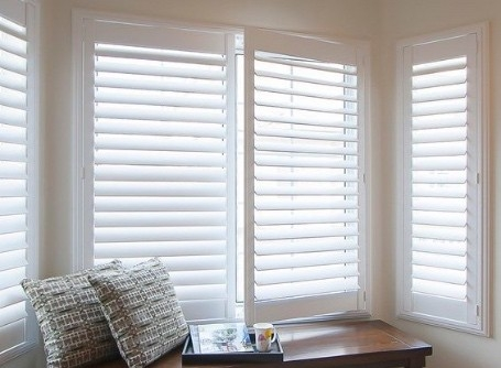 White shutters in front of bay window, Shutters & Blinds of Arizona. Scottsdale AZ