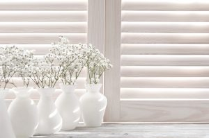 White shutters with small vases in front, Shutters & Blinds of Arizona, Phoenix AZ